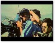 Image 1: Abbas Kiarostami wearing dark glasses in the final scene of Taste of Cherry